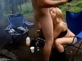 Hungry Blonde Eating Hotdog On Camping