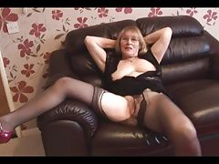 Attractive granny in pantyhose tease