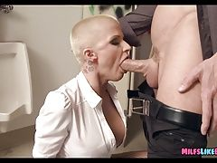 Shaved Head MILF Sucks Him off in the bathroom