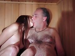 Young girl and elderly man in the sauna