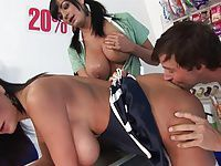 Horny Kit and Kat love sucking guys pole in a shop