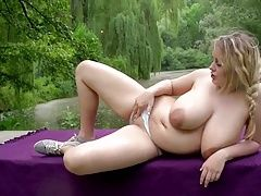 Chubber shows off milky tits outside