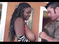 White guy gives black chick with huge natural tits a facial