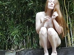 redhead Faith Hatch plays in the bamboo