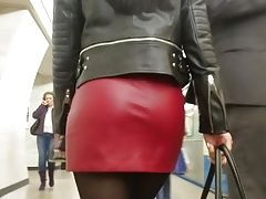 Sexy brunetes ass in red leather skirt