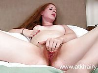 Scarlett Rose masturbates her ginger pussy and gets off hard
