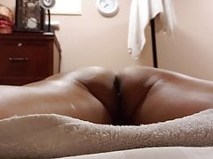 spread out on the massage table