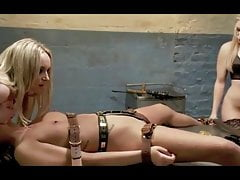 Chastity belted slave gets used by 2 dykes