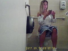 Cute College Teen Gets spied on peeing and changing tampon